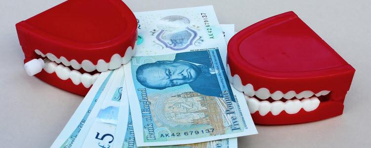 Teeth biting money